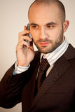 A man with suit uses a phone Stock Photos