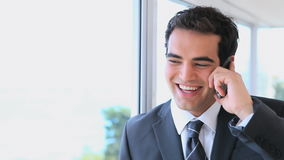 Man in suit using a mobile phone stock video