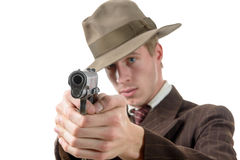 Man in a suit vintage, aim with a gun, on white Stock Photo