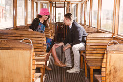 Man in suit in the wagon train with smiling woman  look at each Stock Images