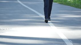 Man in suit walking on the road slowmo.  stock video