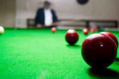 Man in suit watching billiards game Royalty Free Stock Photo