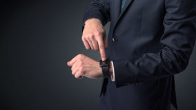 Man in suit wearing smartwatch. Royalty Free Stock Image