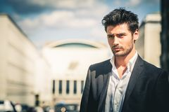 Man in suit and white shirt looking. Outdoors on the street in the city stock photos