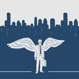 Man in a suit with wings Stock Image