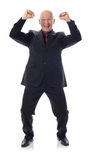 Man in suit winning. With arms in the air  on white Royalty Free Stock Photos