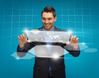 Man in suit working with virtual screens Stock Photo
