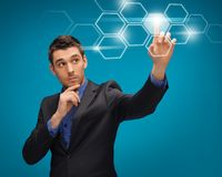 Man in suit working with virtual screens. Picture of man in suit working with virtual screens Stock Photo