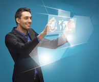 Man in suit working with virtual screens. Picture of man in suit working with virtual screens Royalty Free Stock Photo