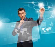 Man in suit working with virtual screens. Picture of man in suit working with virtual screens Stock Image