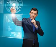 Man in suit working with virtual screens. Picture of man in suit working with virtual screens Royalty Free Stock Photos