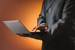 Man in a suit works on a laptop Royalty Free Stock Photos