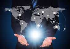 Man in suit, world map and contacts. The concept of global contacts Stock Photo