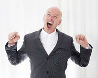 Man in a suit yawning Stock Photography