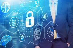 Man in suit and cyber security interface stock images
