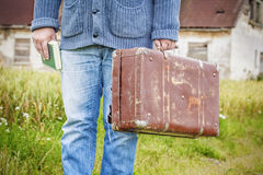 Man with suitcase and book Stock Photography
