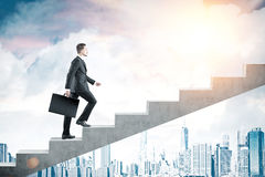 Man with suitcase climbing stairs in city Stock Images