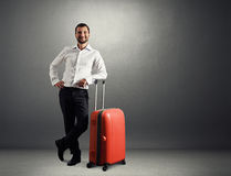Man with suitcase in dark room Royalty Free Stock Photos