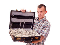 Man with suitcase full of money Stock Photography