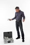 Man with suitcase full of money. Royalty Free Stock Image