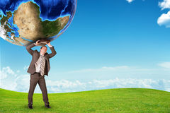 Man with suitcase holding earth Stock Photo