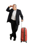 Man with suitcase looking forward Stock Photos