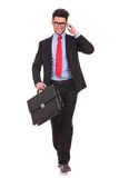Man with suitcase & on phone Royalty Free Stock Photography