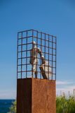 Man with a suitcase; public art Stock Images