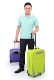 Man with suitcase ready to go. Attractive tourist man with suitcase ready to go Royalty Free Stock Image
