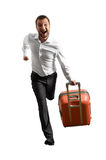 Man with suitcase running the adventure Stock Photography
