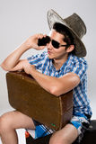 Man with suitcase talking on phone. Stock Images