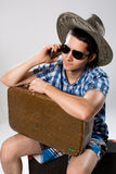 Man with suitcase talking on phone. Royalty Free Stock Photos