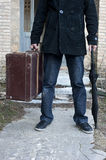 Man with suitcase and umbrella. Stock Images