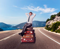Man on the suitcases Stock Images
