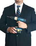 Businessman holding drill Royalty Free Stock Photos