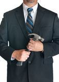 Man in suite holding hammer Royalty Free Stock Photos