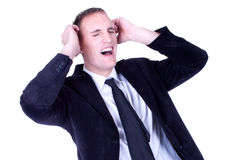 man in a suite, screaming and pulling his hair Royalty Free Stock Photos