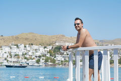 Man on summer vacation enjoying the sea view in Bodrum ,Turkey Stock Image