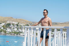 Man on summer vacation enjoying the sea view in Bodrum ,Turkey Stock Photography