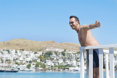 Man on summer vacation enjoying the sea view in Bodrum ,Turkey Stock Photo