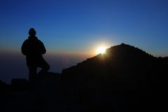 Man on summit of Tajumulco, Guatemala. Silhouette of a climber on the summit of Volcan Tajumulco, Guatemala, the highest peak in Central America, at sunset Royalty Free Stock Photography