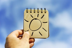 Man and a sun in a notepad Royalty Free Stock Photography