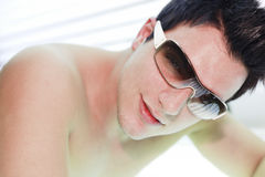Man in a sunbath receiving high degree of Stock Photo