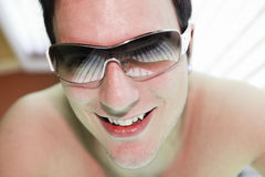 Man in a sunbath receiving high degree of Royalty Free Stock Photo