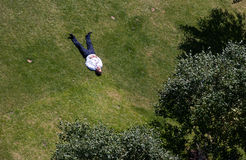 Man sunbathes in a park in central London. An unidentified man sunbathes in the park in London on July 25, 2013. The hottest July temperature in Britain was 36.5 Royalty Free Stock Photo