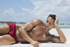 Man sunbathing on the beach Stock Photos