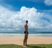 Man sunbathing on a beach. The tropical beach near hotel. Waves of the Indian Ocean Stock Photo