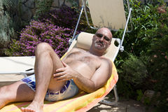 Man Sunbathing In The Garden Stock Images