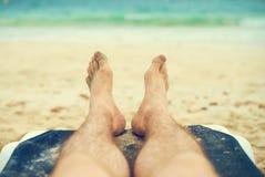 Man sunbathing on lounger. Stock Images