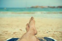 Man sunbathing on lounger. Royalty Free Stock Image
